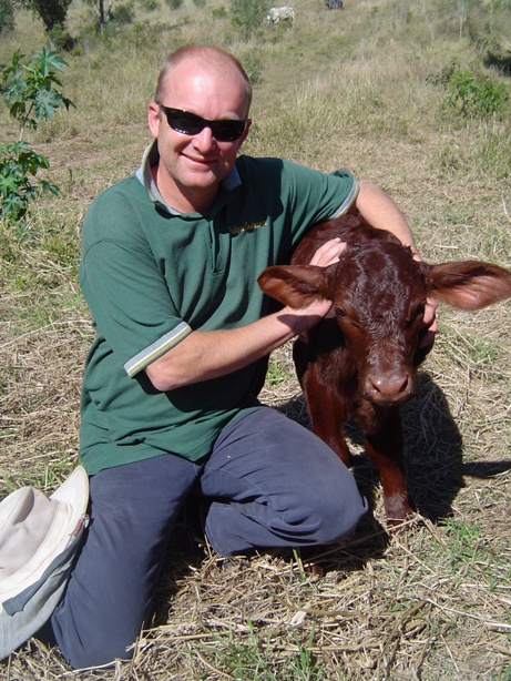 James & newborn bull calf in 2010.